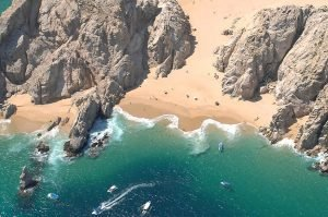 Playa del Amor or Lover's Beach in Cabo San Lucas, with Divorce Beach in the background.